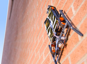Electroadhesive Surface-Climbing Robots