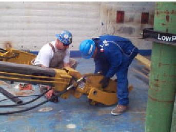 Operators changing attachment during demolition demonstration.